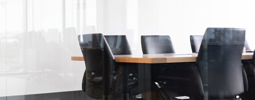 Office chairs in bright conference room setting